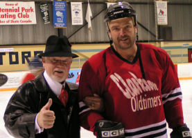 Don Cherry assisted off the ice surface